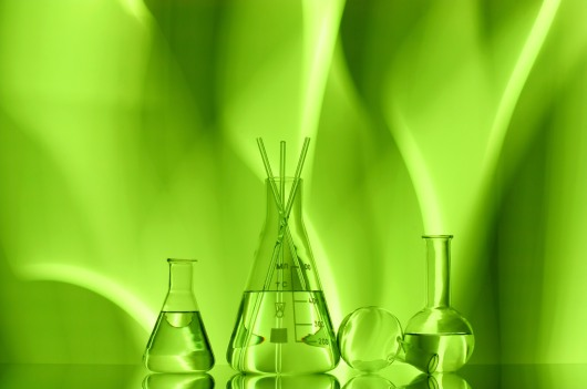 laboratory Glassware on a green background