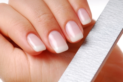 Body-care of hands. Woman polishing nails
